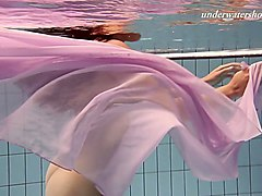 charming curly babe paulinka shows striptease under the water