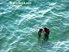 sweet girlfriend and her man were sunbathing nude on the beach