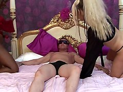 black and white sluts team up to satisfy e horny fucker