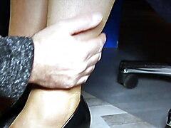 under the desk on the nylon feet by secretary