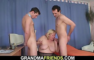 Busty blonde old grandma swallows two cocks