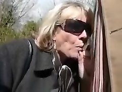 Mature woman doing a blowjob in the car