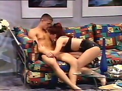 naughty and hot redhead white lady pleasures man orally on the sofa