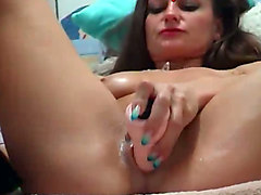 hot russian milf is drilling her tight anus with her sex toy on webcam