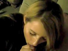 blonde girl gives a guy a blowjob after the party