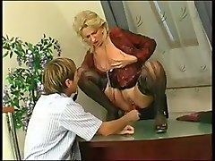 Secretary in sexy nylons uses dildo and a man