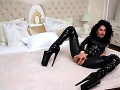 catsuit, corset + extreme thighboots