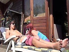 Stacked redhead milf sucks and fucks a young cock outside