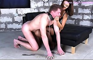 Cruel mistress in stockings humiliates the slave and beats him with a whip.