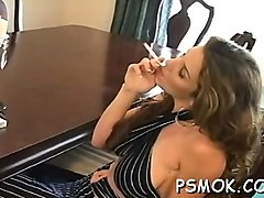 older slut blows a guy while smoking a cigarette