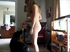 Naked teen with a sweet ass plays with her dog on hidden cam