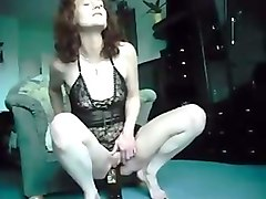 curly haired old fashioned lusty redhead milf was fucking her own slit