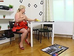 blonde old fattie in red dress strips and plays with a banana