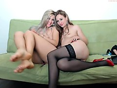 Two beautiful young lesbians have fun with a strap-on toy