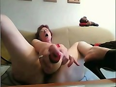 mature woman poking wet vagina with huge sex toy