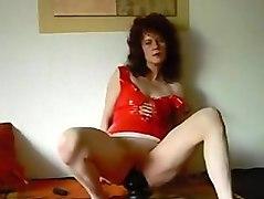 german milf sit on black cone dildo