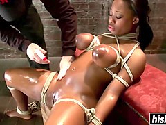 tied up ebony gets pleasured with toys