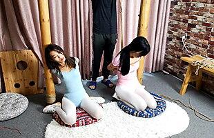 Double gymnastics suit (asian-bondage.com)