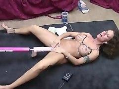 hot brunette gets machine fucked on floor with big cock