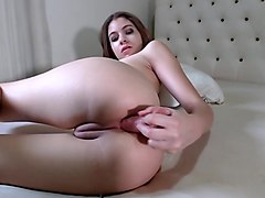 Hot chick fucks her asshole with a dildo