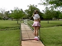 Plaid skirt with pink pumps and frilly socks