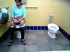 Desi Nri Aunty Caught Pissing In Toilet