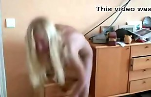 crazy girl  screws her snug shaved pussy by using a large vibrator