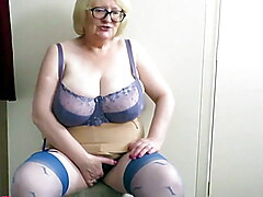 Busty Mature blonde in blue stockings and heels