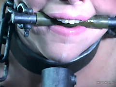 bearded dude makes use of clamps, dildo, plastic bag and weights to punish skinny katy kiss