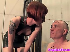 harsh femdom torments submissive with whip