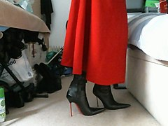 red midi skirt and pointed italian thigh high boots