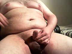 Fat guy playing and stroking