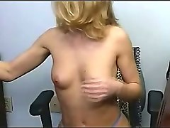 blonde office whore undresses and shows her goodies on cam