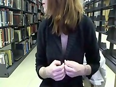 gorgeous red haired librarian flashes her tits on webcam at work